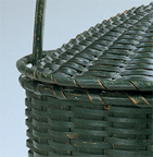 Green painted round basket with captured lid